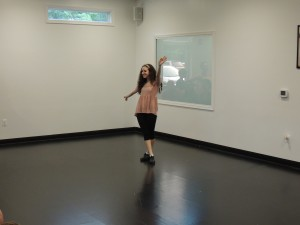 Libby showing off her quick feet during her tap routine!