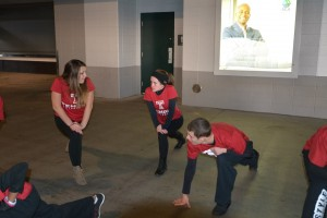 Freestyle Dancers stretching before performing at Lincoln Financial Field